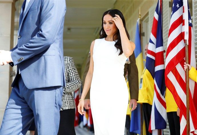 Meghan stepped out in Sydney wearing a stunning white dress by Australian designer Karen Gee. *(Image: Getty Images)*