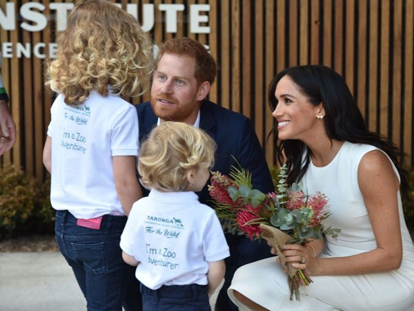 Harry and Meghan have a renowned rapport with the public who flock to meet them, including children like Findlay (right) and Dasha.
