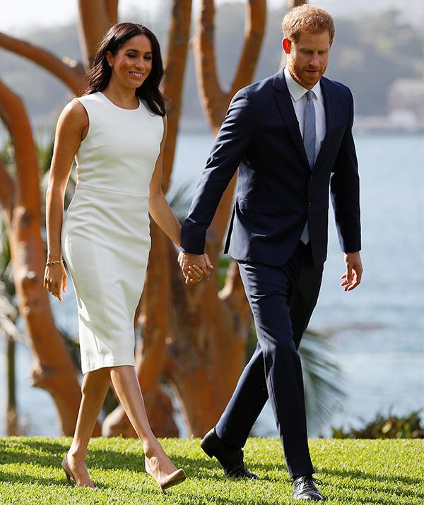 The Duchess wore this stunning white dress by Australian designer Karen Gee to Admiralty House on the first morning of the couple's Australian tour. The frock itself is named the 'Blessed' dress - how fetching! *(Image: Getty Images)*