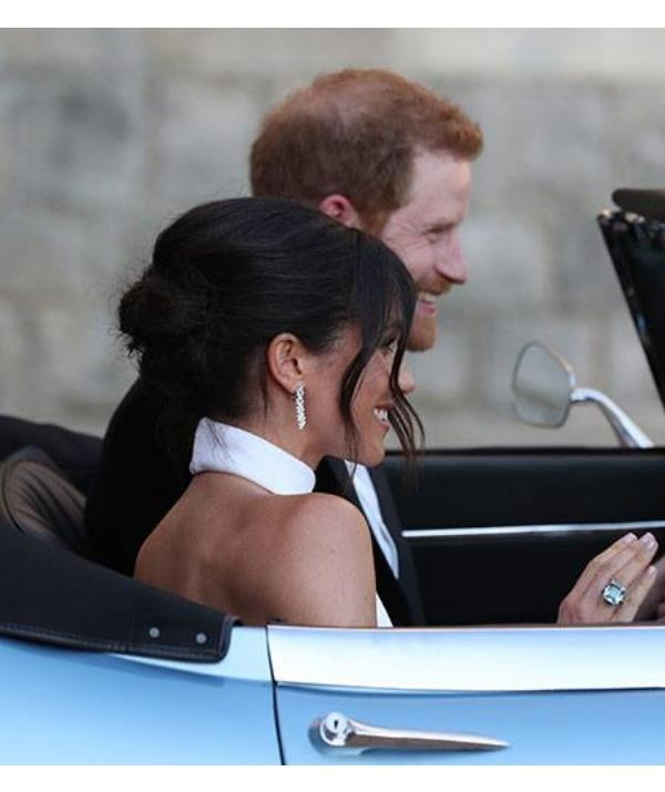 The Duchess of Sussex wore Princess Diana's aquamarine cocktail ring to the evening reception of her wedding to Prince Harry in May this year. *(Image: Getty)*