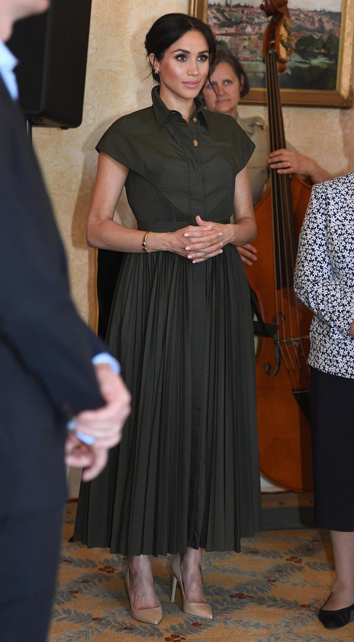 During an event at Admiralty House on Tuesday afternoon, Meghan wore this khaki green shirt dress by US designer Brandon Maxwell. *(Image: Getty Images)*