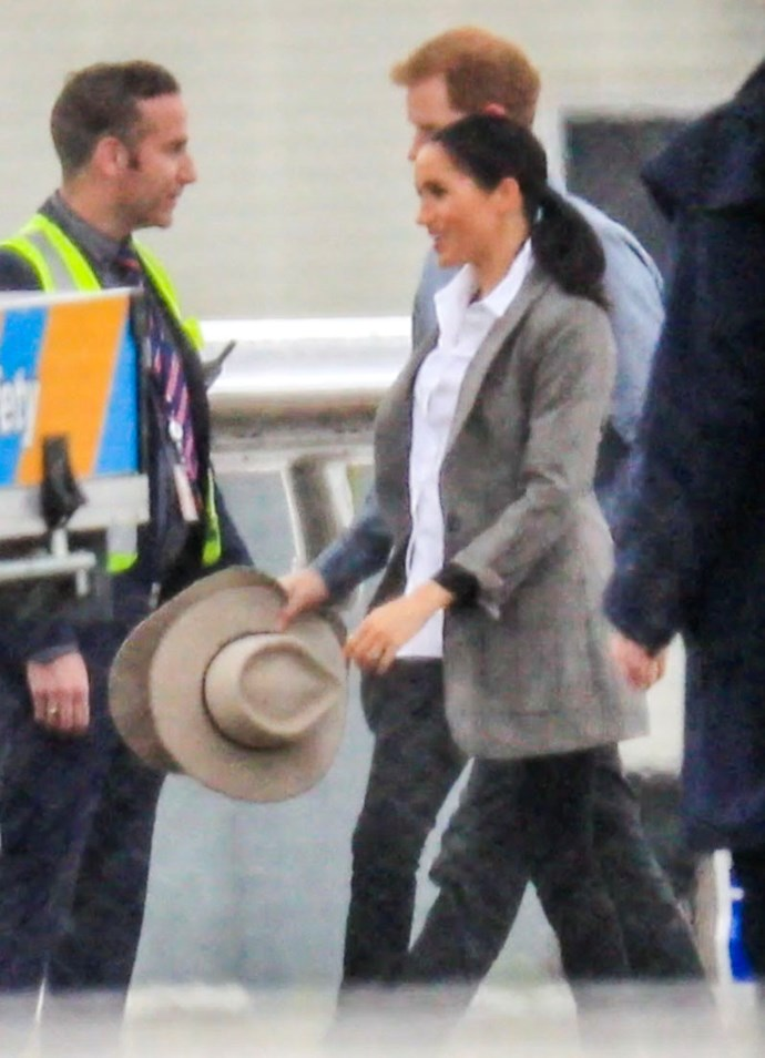 To finish off the country-esque get-up, Meghan and Harry were snapped boarding their flight to Dubbo holding Akubra hats. We hope they wear them! *(Image: Media Mode)*