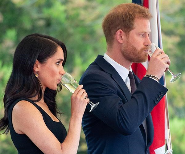 The last hurrah! Meghan and Harry were last seen with a drink in hand back in July. *(Image: Getty Images)*