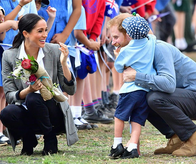 Hug it out! Local school boy Luke was thrilled to meet the Duke and Duchess of Sussex.
