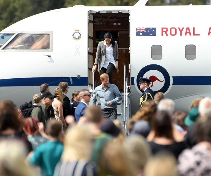 Prince Harry and Duchess Meghan touch down in Dubbo. *(Image: Getty Images)*