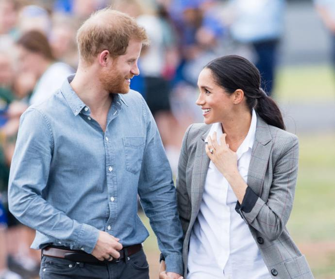 Harry and Meghan's personal moment during their visit to Dubbo. *(Image: Getty Images)*