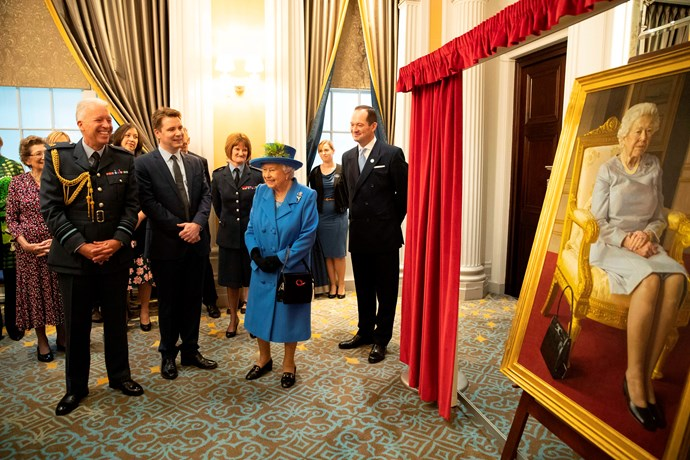 Onlookers broke into applause when the picture was unveiled. *(Image: Getty Images)*