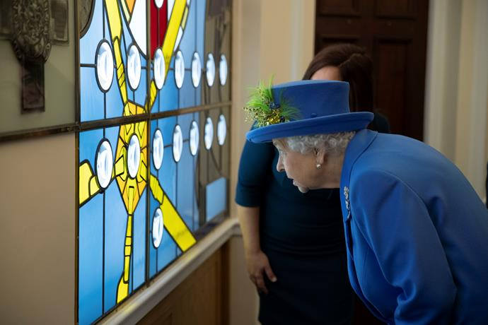 The Queen enjoyed mingling with guests and viewing an impressive stained glass window. *(Image: Getty Images)*