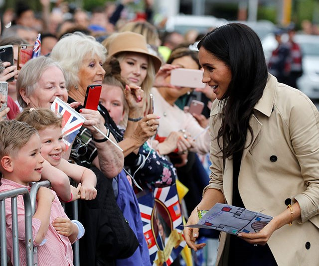 Meghan is given a homemade card from one of the children.