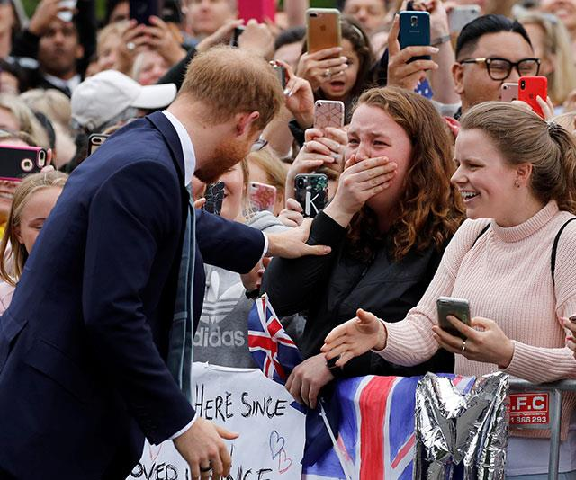 Prince Harry comforts an overwhelmed fan.