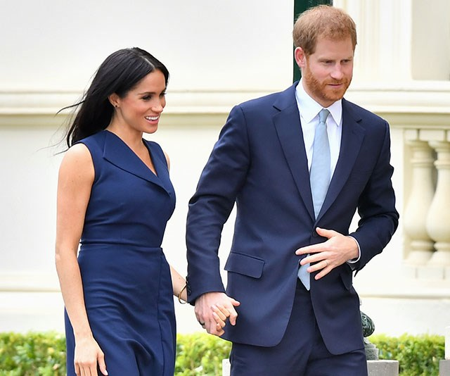 Matching their navy ensembles, Meghan stunned in a deep-blue dress by Australian designer Dion Lee paired with the same Martin Grant trench coat she wore in Sydney two days ago.