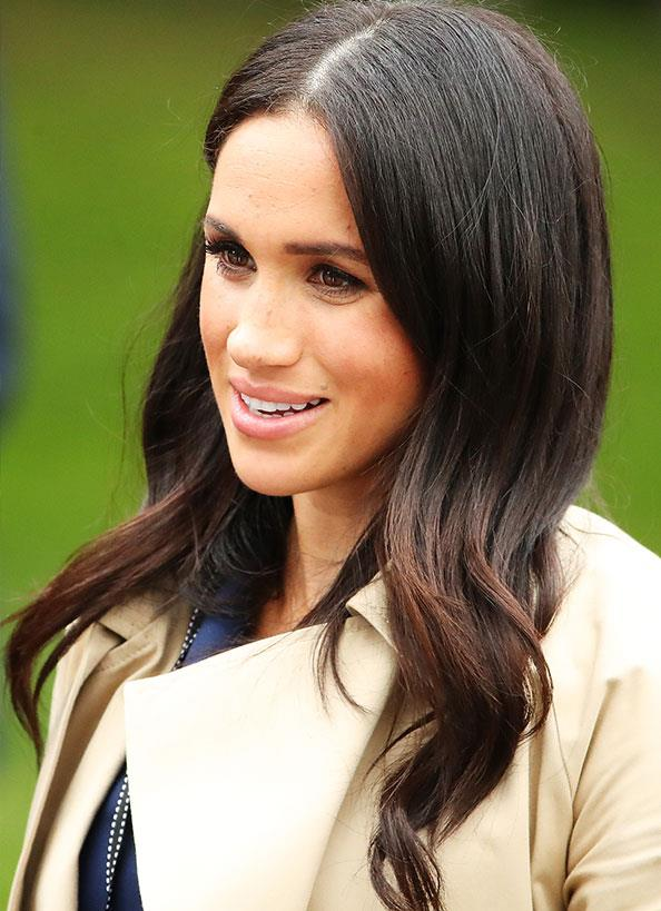 Meghan's princess-perfect locks were worn out in a shiny blow-dry.