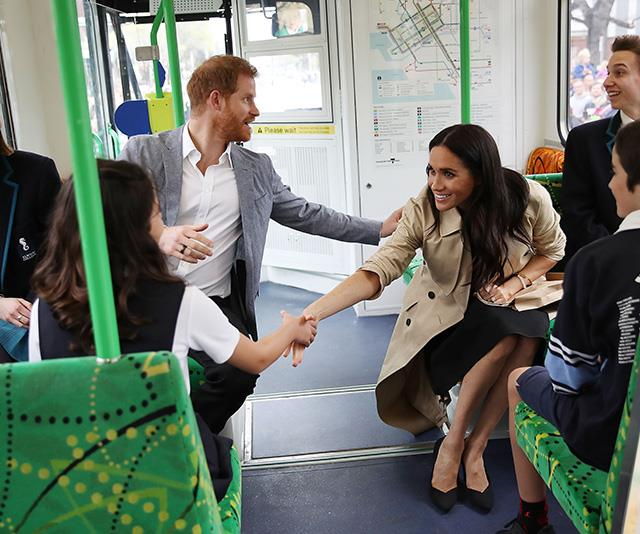 Meghan and Harry greeted students on the tram to South Melbourne beach. *(Image: Getty Images)*