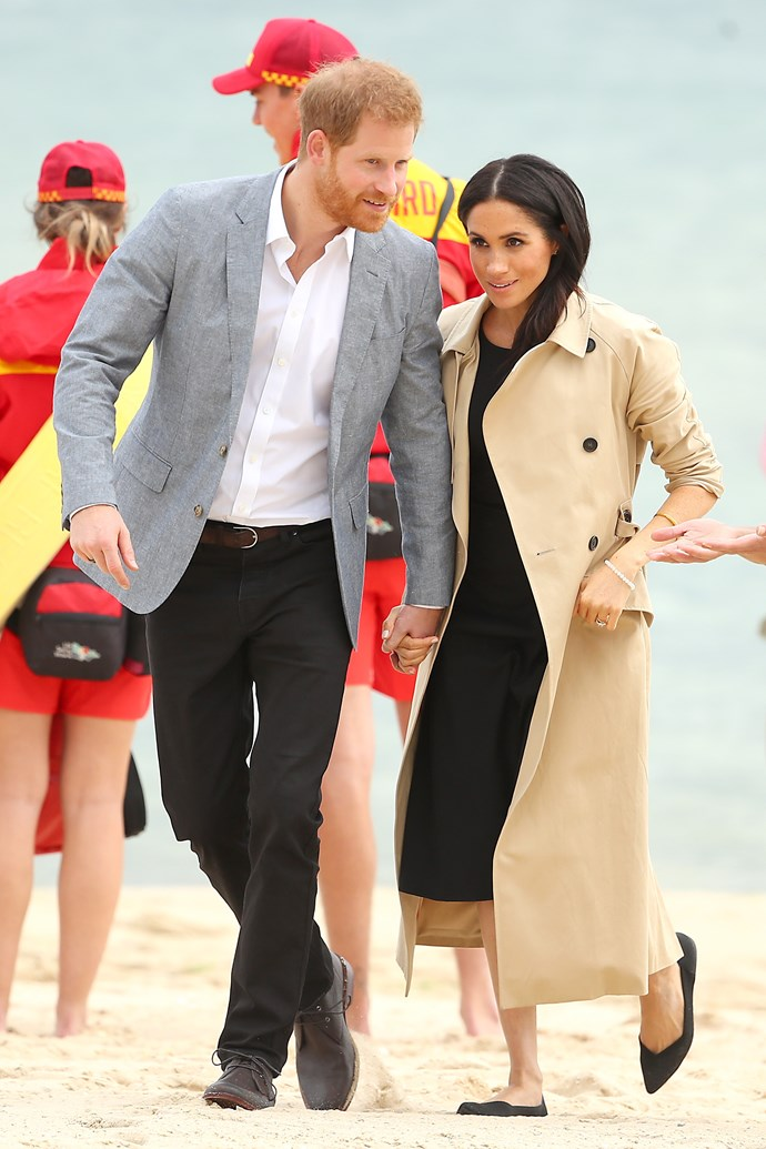 The pair met with volunteers who clean the beach. *(Image: Getty Images)*