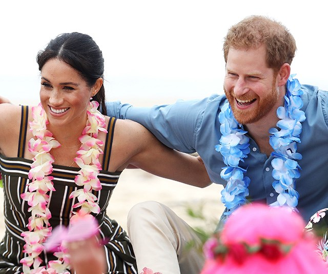 Sitting in an 'Anti Bad Vibe Circle' on the beach, Harry and Meghan shared some sweet interactions with the locals.  *(Image: Getty Images)*