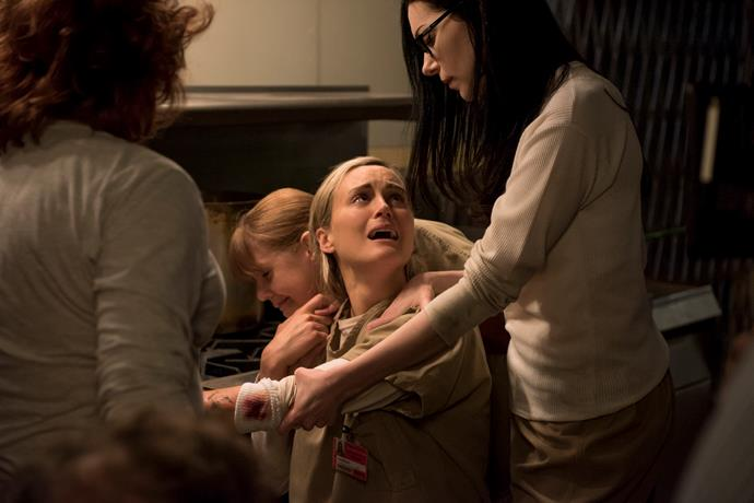 **PIPER GETS BRANDED**  After getting on Dominican and Maria's wrong side by starting a White Power group within the facility, Piper finds herself branded with the Swastika symbol on her arm. Unfortunately for Piper she had to learn a lot of lessons the hard way.