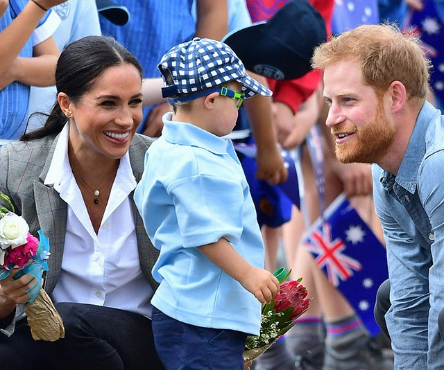 Harry and Meghan are naturals with young royal fans. *(Image: Getty Images)*