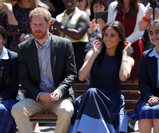 Prince Harry and Duchess Meghan delighted students at Macarthur Girls School on Friday. *(Image: Getty Images)*