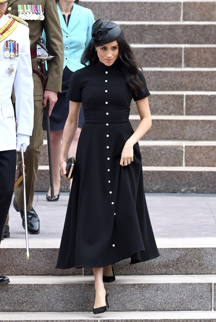 Stunning in a black Emilia Wickstead dress, Meghan looked the image of class as she and Harry attended a service to open an extended Anzac Memorial in Hyde Park. *(Image: Getty Images)*