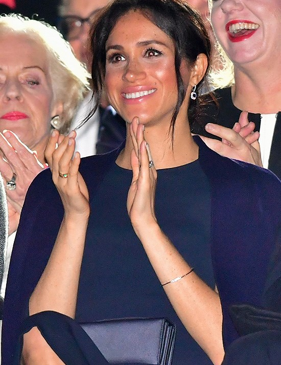 For her accessories, Meghan held a Dior clutch bag and wore some sparkling sapphire diamond drop earrings. *(Image: Getty Images)*