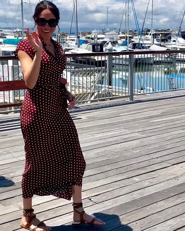 Paired with some brown gladiator sandals designed by Sarah Flint and sunglasses, the Duchess looks ready for a summery day ahead!  *(Image: Instagram / @herveybayecomarinetours)*