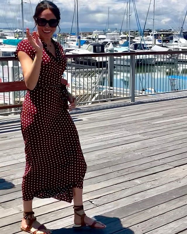 Finishing the look with a pair of brown gladiator sandals and large black sunglasses, the Duchess was the image of effortless chic. *(Image: Instagram / @herveybayecomarinetours)*