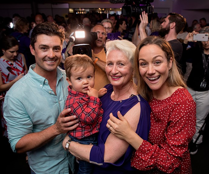 Dr Phelps celebrates her victory with daughter Jaime Chambers, son-in-law Rob Chambers and grandson Billy Chambers. *(Image: AAP)*