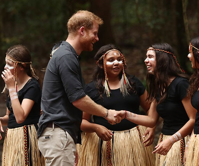 Prince Harry meets with the young women of the K'gari tribe under the Queens Canopy. *(Image: Getty)*