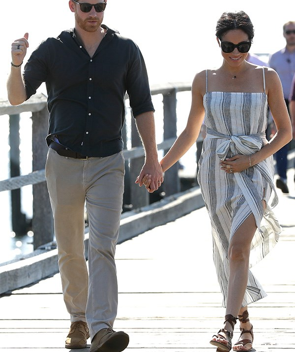 Baby bump alert! The floaty dress complimented Meghan's growing tummy. *(Image: Getty Images)*
