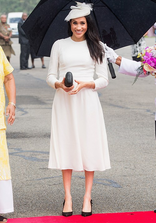 Touchdown in Fiji! Meghan made her grand entrance to the South Pacific country in a stunning white dress designed by Australian label Zimmerman. *(Image: Getty Images)*