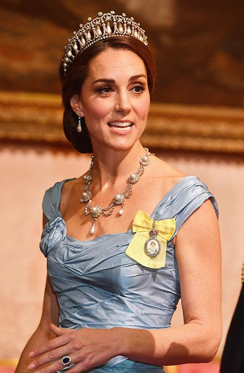 Honouring her late mother-in-law, Kate wore Princess Diana's Cambridge Lover's Knot Tiara and the late Princess' Collingwood pearl earrings. But it was the Royal Family Order of Queen Elizabeth II badge from the monarch that made Kate's outfit extra special. *(Image: AAP)*