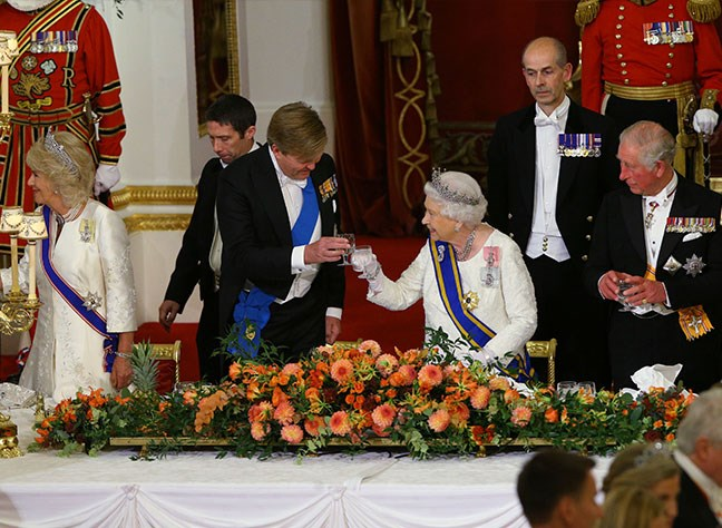 Cheers! The Queen and King Willem-Alexander share a toast.