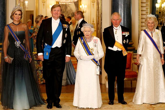 King Willem-Alexander, Queen Maxima, Queen Elizabeth II, Prince Charles and Camilla, Duchess of Cornwall pose for a group shot. *(Image: Getty)*