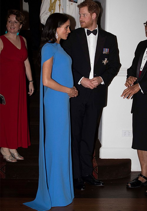 The Duchess finished the striking look with dripping crystal earrings - the image of pure class! *(Image: Getty Images)*