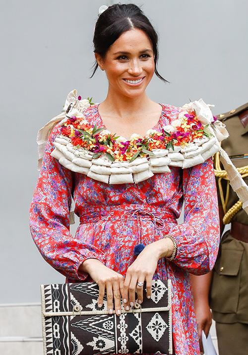 Meghan embraced Fijian culture in all its colourful glory on Wednesday morning, wearing a bright printed ruffle dress by Figue. *(Image: Getty Images)*