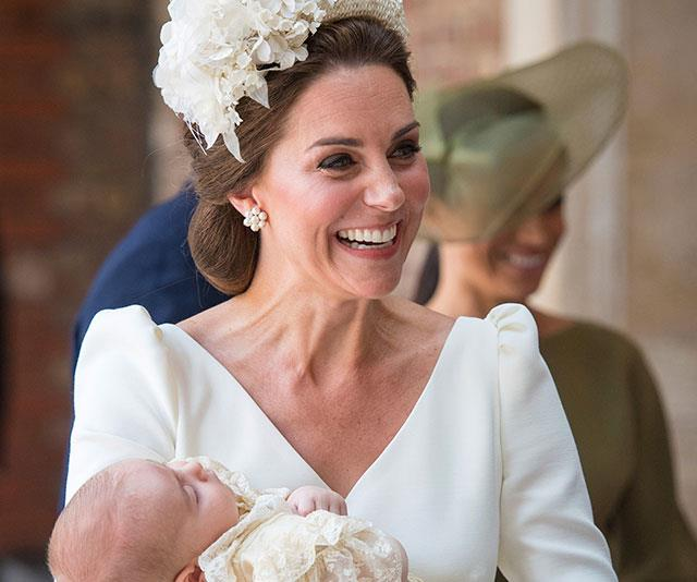 A beaming Catherine with Prince Louis on his christening day. *(Image: AAP)*