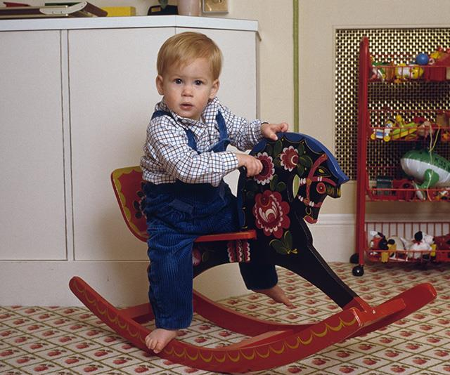 Like his now-wife, Prince Harry was always well dressed, even if it was just for a trip to the playroom!  *(Image: Getty Images)*
