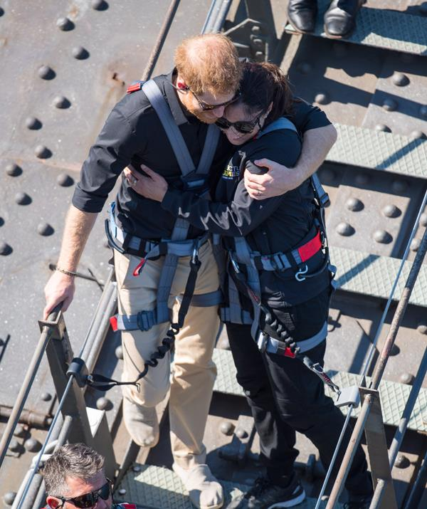 Prince Harry had something surprising to say to his aides after he was snapped hugging Invictus Games ambassador Gwen Cherne as they climbed the Harbour Bridge in Sydney on Friday. *(Image: Getty Images)*