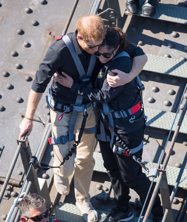 Prince Harry hugs Invictus Games ambassador Gwen Cherne after climbing the Sydney Harbour Bridge on Friday.