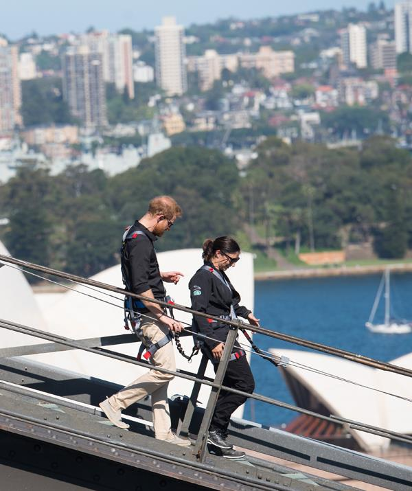 Prince Harry was spotted in deep conversation with Gwen Cherne as they walked down the other side of the Harbour Bridge after their climb. *(Image: Getty Images)*