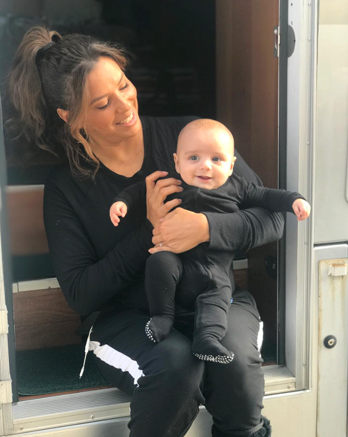 Proud working mum, Eva is matchy-matchy in all black with the super-cute Santiago on set of *Dora the Explorer* movie, where she'll play Dora's mum.