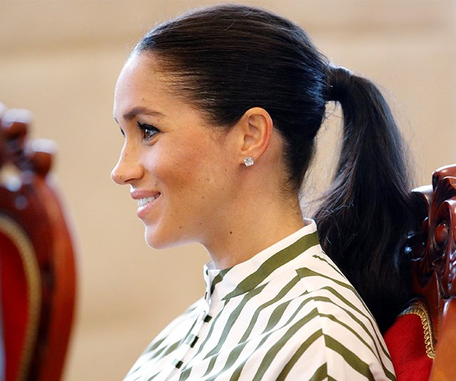 The Duchess wore her dark hair in a chic pony-tail. *(Image: Getty Images)*