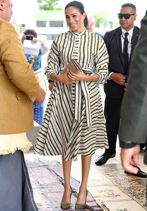 Arriving at the St George Government Building in Tonga on Friday morning, Meghan's asymmetrical stripe dress by Australian designer Martin Grant was smart, yet comfortable for the pregnant royal. *(Image: Getty Images)*