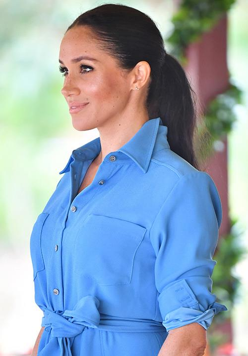 The pregnant royal looked radiant in the bright shirt dress, named 'Cara'. *(Image: Rex)*