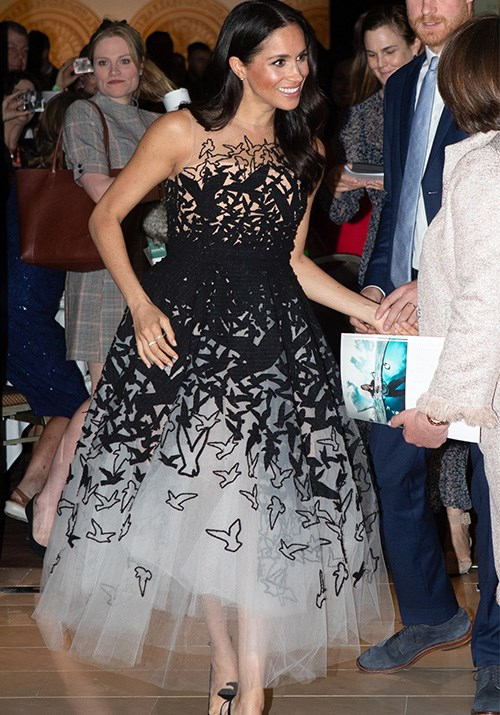 Looking like she just stepped out of a fairytale, Duchess Meghan looked utterly divine in this Oscar de la Renta gown. The black and white design with bird silhouettes and a tulle skirt was eye-catching and unique - this might be one of our favourite looks on the Duchess so far! *(Image: Getty Images)*