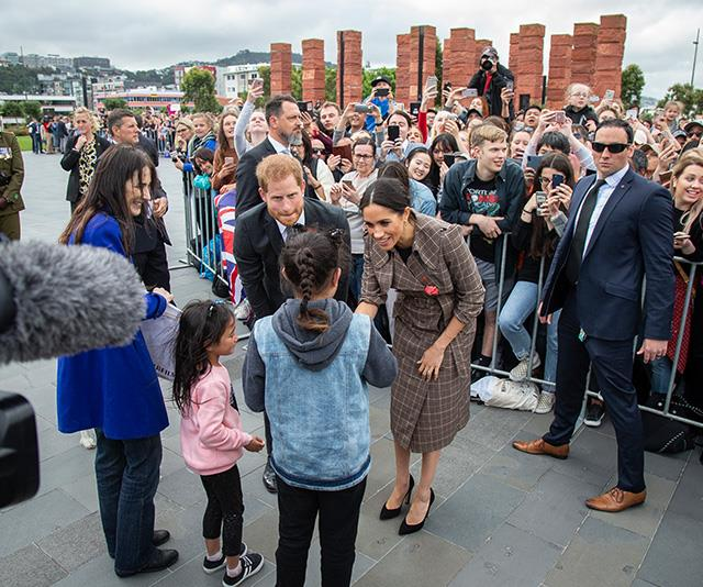 Thousands of royal fans, young and old, waited to meet the Duke and Duchess. *(Image: Getty Images)*