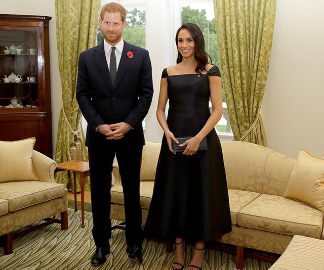 Meghan attended a reception to mark the 125th anniversary of women's suffrage in New Zealand on Sunday wearing a Gabriela Hearst navy gown. Interestingly, the dress originally had spaghetti straps, but it was modified with capped sleeves for the occasion.  *(Image: Getty Images)*