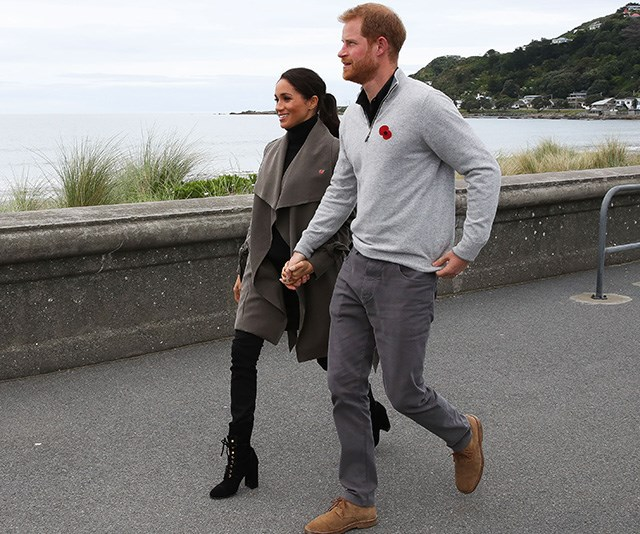 Stepping out in Wellington on Monday morning, the royal couple looked cool and casual with Meghan in a Club Monaco trench coat. *(Image: Getty Images)*