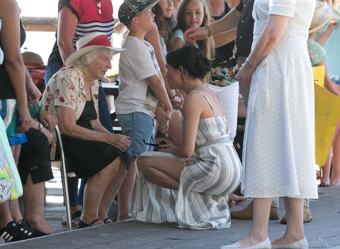 The thigh-high slits in Meghan's Queensland ensemble also turned heads. *(Image: Media Mode)*