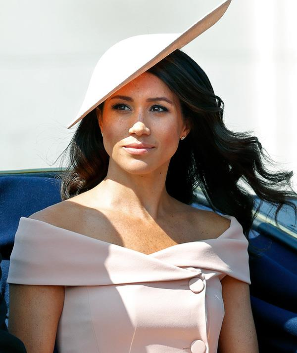 Meghan's off-shoulder ensemble was also against royal protocol, according to *Page Six*. *(Image: Getty)*